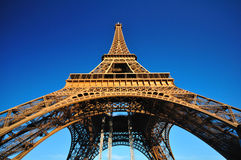 Eiffel tower from below on blue sky Royalty Free Stock Photos