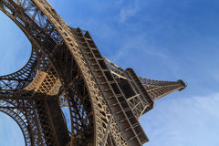 Eiffel Tower from below. Dramatic slanted picture of the Eiffel Tower rising up into the blue sky Royalty Free Stock Image