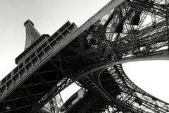 Eiffel Tower Below Perspective in Paris France. The Eiffel Tower landmark steel structure and pylon leg detail with iron beams assembly up perspective view from Stock Images