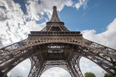 Eiffel Tower from beneath. Eiffel Tower in Paris from beneath against bright sky Stock Photo