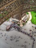 Eiffel Tower Birds Eye View. Tourists queue up to purchase tickets to enter the Eiffel Tower Royalty Free Stock Photos