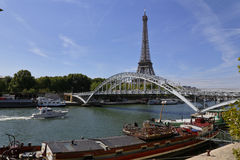 Eiffel Tower & blue sky with clouds, Paris, France - view from water with arched bridge over River Seine - JULY 24, 2015 Royalty Free Stock Photo