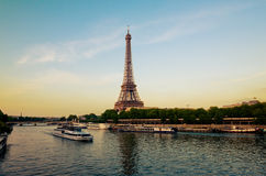 Eiffel Tower with boats in evening Paris Stock Photo
