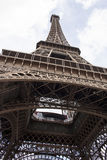 The Eiffel Tower bottom view. This is an image of the Eiffel Tower bottom view. From this perspective it can be seen very well the brown metal structures. The Stock Images