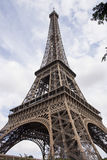 The Eiffel Tower bottom view. This is an image of the Eiffel Tower bottom view. From this perspective it can be seen very well the brown metal structures. The Stock Photography