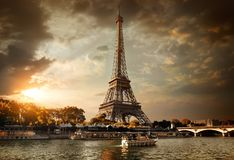 Clouds over Paris. Eiffel Tower and bridge Iena on the river Seine in Paris, France Stock Image