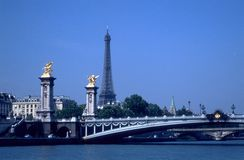 Eiffel tower and bridges over Seine. View of the Eiffel Tower, taken from a boat on Seine Stock Photo