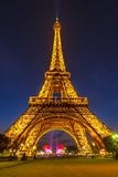 Eiffel Tower brightly illuminated at dusk Royalty Free Stock Image