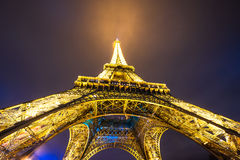 Eiffel Tower brightly illuminated at dusk Royalty Free Stock Images