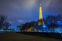Eiffel Tower brightly illuminated at dusk. PARIS - DECEMBER 22: Eiffel Tower brightly illuminated at dusk on December 22, 2014 in Paris. The Eiffel tower is the Stock Photos
