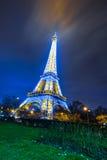 Eiffel Tower brightly illuminated at dusk. PARIS - DECEMBER 22: Eiffel Tower brightly illuminated at dusk on December 22, 2014 in Paris. The Eiffel tower is the Stock Image