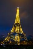 Eiffel Tower brightly illuminated at dusk. PARIS - DECEMBER 22: Eiffel Tower brightly illuminated at dusk on December 22, 2014 in Paris. The Eiffel tower is the Stock Photography