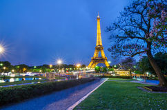 Eiffel Tower brightly illuminated at dusk, Paris Royalty Free Stock Images