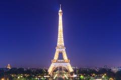 Eiffel Tower brightly illuminated at dusk Royalty Free Stock Images