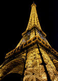Eiffel Tower brightly illuminated at dusk in Paris. Royalty Free Stock Photos