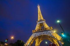 Eiffel Tower brightly illuminated at twilight, Paris Stock Image