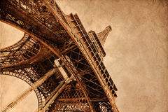 Eiffel Tower with brown texture. The Eiffel Tower in Paris in a low angle view, overlaid with a brown texture from old cardboard Royalty Free Stock Image
