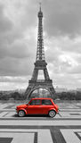 Eiffel tower with car. Black and white photo with red element. vector illustration