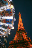 Eiffel Tower and Carousel by Night Stock Images