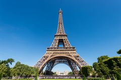 Eiffel Tower from the Champ de Mars gardens in summer. Royalty Free Stock Image