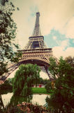 Eiffel Tower from Champ de Mars park in Paris, France. Vintage Stock Photos