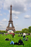 Eiffel Tower and Champs de Mars. The Eiffel Tower in Paris, France. In the foreground Champs the Mars can be seen. A popular place for both locals and tourists Royalty Free Stock Photos