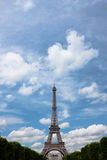 Eiffel tower with clouds. Portrait. The Eiffel tower monument with blue sky and clouds stock images