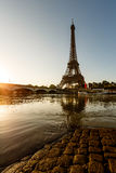 Eiffel Tower and Cobbled Embankment of Seine River at Sunrise Stock Photos