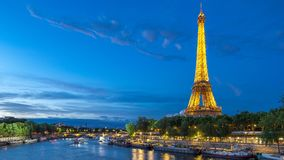 The Eiffel Tower day to night Timelapse with boat station. Paris, France. The Eiffel Tower day to night transition Timelapse reflected on water with boat station stock video footage