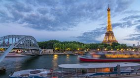 Eiffel tower with Debilly Footbridge and Jena bridge over Seine river day to night timelapse, Paris, France. Eiffel tower with Debilly Footbridge and Jena bridge stock footage