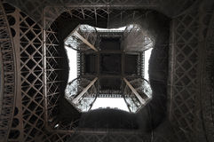 Eiffel Tower from directly below. View of the center Eiffel Tower standing right at the bottom royalty free stock image
