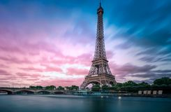 Eiffel Tower with dramatic evening light and silky Seine River Royalty Free Stock Image