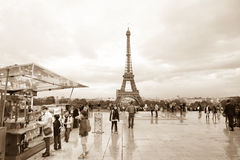 Eiffel tower at dusk. Paris, France, October 7, 2011 - Parisian city life around Eiffel tower Royalty Free Stock Images