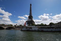 Eiffel Tower. Is river, waterway and tourist attraction. That marvel has landmark, water and cloud and that beauty contains sky, tower and tree. (According to stock photography