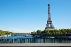 Eiffel tower and empty sidewalk bridge on Seine river in Paris Royalty Free Stock Photography