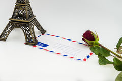 Eiffel tower and envelope with red rose Stock Image