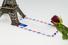 Eiffel tower and envelope with red rose Royalty Free Stock Photo