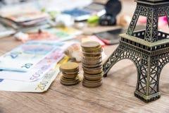 Eiffel Tower with euro money on desk. Stock Photo