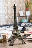 Eiffel Tower with euro money on desk. Royalty Free Stock Photography