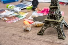 Eiffel Tower with euro money on desk Stock Photo