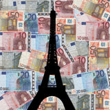 Eiffel tower with euros. Eiffel tower Paris with colourful euros background Royalty Free Stock Photo