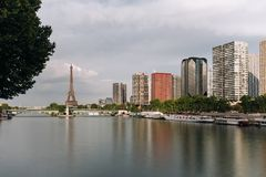Eiffel tower, famous Paris symbol and iconic landmark in France and residential buildings close to the Seine river on a Stock Photos