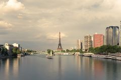 Eiffel tower, famous Paris symbol and iconic landmark in France and residential buildings close to the Seine river on a Stock Photo