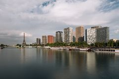 Eiffel tower, famous Paris symbol and iconic landmark in France and residential buildings close to the Seine river on a Royalty Free Stock Photo