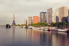 Eiffel tower, famous Paris symbol and iconic landmark in France and residential buildings close to the Seine river on a Royalty Free Stock Photos