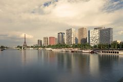 Eiffel tower, famous Paris symbol and iconic landmark in France and residential buildings close to the Seine river on a Stock Images
