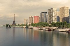Eiffel tower, famous Paris symbol and iconic landmark in France and residential buildings close to the Seine river on a Stock Photography