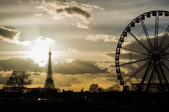 Eiffel Tower and Ferris Wheel at Place de la Concorde in Paris Seen at Sunset Royalty Free Stock Images