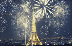 Eiffel tower with fireworks, New Year in Paris. Eiffel tower with fireworks, celebration of the New Year in Paris, France - retro styled photo Royalty Free Stock Photography