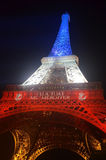 The Eiffel Tower in Flag colors. The Eiffel Tower on 18th Nov 2015 lit up with colors of the French Flag stock images